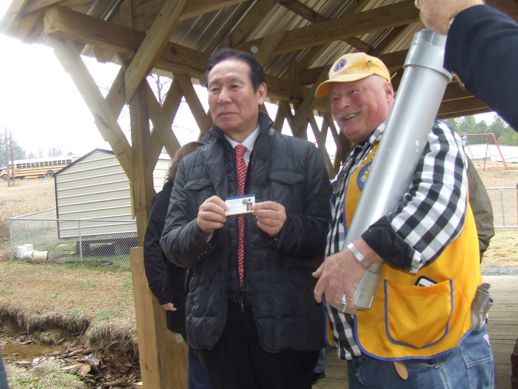 VP Choi presenting President Tim Sosbee with his card and pin to be placed in the 100 year time capsule