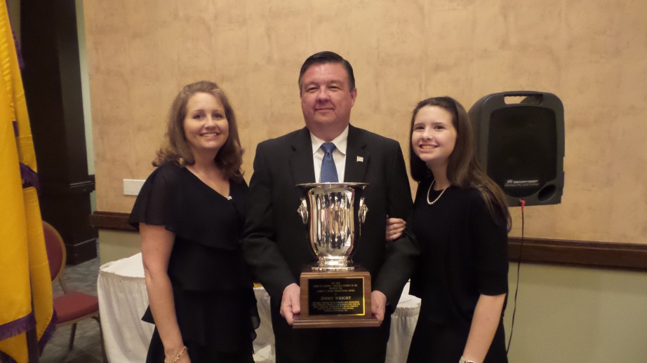 Mr. Jimmy Wright received the  Aubrey D. Green Humanitarian Award. Next to him is wife Susan and daughter Emily.